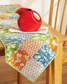 Setting a stylish table is easy with this colorful runner. Scrappy rows of squares set on point come together fast for dynamic effect.