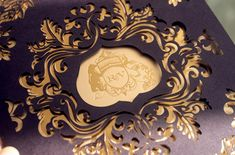 Rebecca + Varun's Lasercut and Gold Foil Wedding Invitations-- i like the crest in the middle of a laser cut design