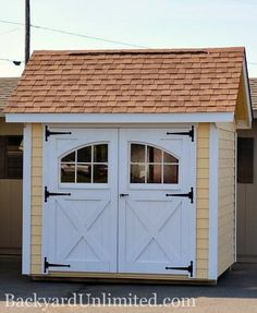 8'x8' Garden Shed with Lap Siding, Carriage House Doors, and Roll Ridge Vent http://www.backyardunlimited.com/sheds/garden-sheds