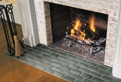 Subway tile fireplace from This Old House.