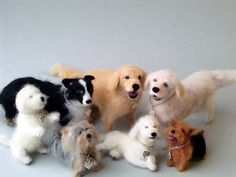 These group of dogs are needle felted of wool, alpacka and silk.