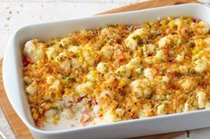 Get out the casserole dish for our Creamy Baked Cauliflower recipe. The family will love this cheesy baked cauliflower with sweet corn and garlic dish. Creamy Baked Cauliflower is a great side dish for special occasions, but it Vegetable Dishes, Vegetable Recipes, Vegetarian Recipes, Healthy Recipes, Healthy Foods, Baked Cauliflower, Cauliflower Recipes, Cauliflower Casserole, Cauliflower Nuggets