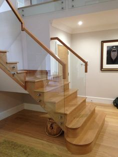This open string Oak staircase looks elegant with the glass balustrade Glass Balustrade, Staircases, Joinery, Stairs, Dining Table, Elegant, Projects, Furniture, Home Decor