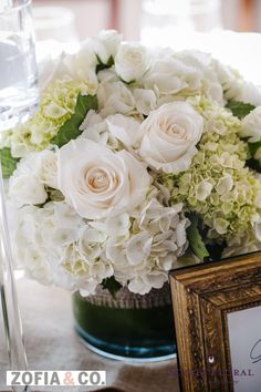 white and green centerpiece by Soiree Floral