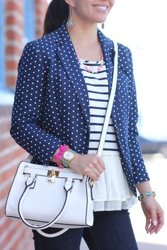 So much animation!  Mixing two sizes of polka dots and stripes. Ruffles, pops of color all over with jewelry.  Love it