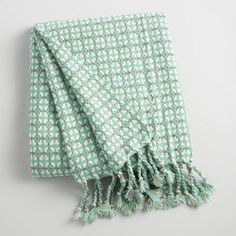 When there's a chill in the air, there's nothing cozier than wrapping yourself in the eye-catching aqua and white woven pattern of this soft throw featuring twisted tassel accents at each end.