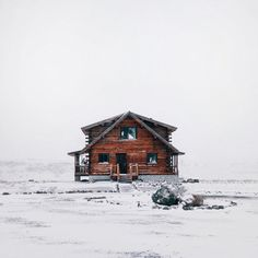 I dream of a house with only snow being seen around it.
