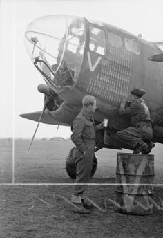 Groundcrew of No. 223 Squadron RAF paint the 105th bomb symbol on the nose of Martin Baltimore Mark IV, 'V' for Vera, at Celone, Italy, to signify the number of successful operations carried out by the aircraft. 'V' for Vera's fitter, Leading Aircraftman P Cowell of Kettering, Northamptonshire holds the paint can, while the rigger, LAC T Newton of Cirencester, Gloucestershire, wields the brush.