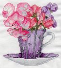 Vermillion Stitcherys Gift to All Stitchers! Sweetpeas. Click on color chart below photo. A photo for every month.