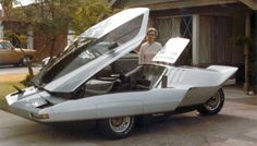 Edna Will poses next to the Phantom with the door and engine access open.