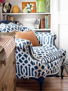 Revive your grandmother's fussy mahogany armchair with high-gloss indigo paint and a graphic trellis-print fabric from Schumacher.