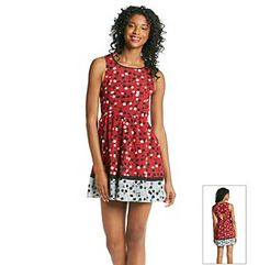Dresses. Excite your look with this fun printed dress from Eric   Lani that features a sassy cut out detail in the back and allover artistic floral scribble print. Featured in ruby Scoopneck Sleeveless Allover floral print Cut out detail in back Hidden side zip Polyester Imported