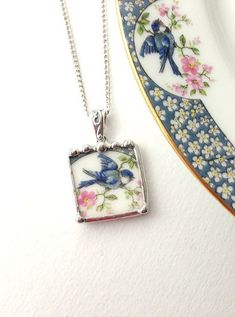 Best 12 Broken china jewelry pendant necklace antique bluebird china made from a broken porcelain plate Porcelain Jewelry, Ceramic Jewelry, Glass Jewelry, Pendant Jewelry, Pendant Necklace, Jewelry Crafts, Jewelry Art, Vintage Jewelry, Handmade Jewelry