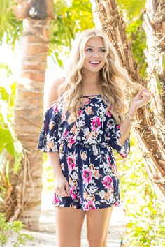 This sweet floral romper is the perfect combination of spring prints and summer fun! We love the beautiful combination of hot pink, orange, navy, white, dark green, and mustard in this gorgeous look -