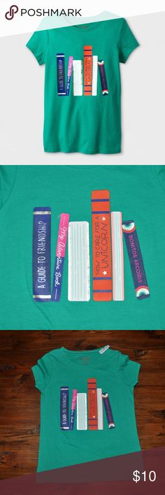 New CAT & JACK Short-Sleeve Book Graphic T-Shirt Let her bookworm side shine with this Short-Sleeve Book Graphic T-Shirt from Cat and Jack. In green, this graphic tee features book spines in blue, pink and orange. Whether she's curled up with an old favorite or writing her own book, she'll love adding this book-themed to her closet.   size XS condition: new without tags color: green  @cjrose25  Bundle your likes for a private discount. Cat & Jack Shirts & Tops Tees - Short Sleeve