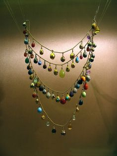 Faberge - small eggs strung on an18k gold triple strand necklace