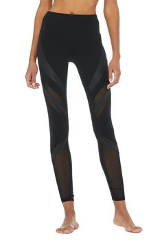 d69a0a250cf86 The Alo Yoga Epic Legging is modern with on trend fabric blocking and matte  and shine