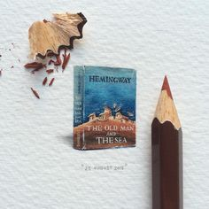 "Day 50/100 (13/25 #tinytuesdays) : ""The Old Man and the Sea"" by Ernest Hemingway. 21 x 23 mm. The novel was the last major work of fiction to be produced by Hemingway and published in his lifetime, and was cited by the Nobel Committee as contributing to the awarding of the Nobel Prize in Literature to Hemingway in 1954. THIS PAINTING WILL BE UP FOR AUCTION FOR A WEEK STARTING ON 27 AUGUST 2015. #potluck100pfa #tinytuesdays #miniature #watercolour #paintingsforants"