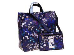Borsa donna da giorno blu scura con fiori dotata di pochette interna, staccabile ed utilizzabile singolarmente. La firma è di Paul Albert Dari, stilista di Paul Meccanico.