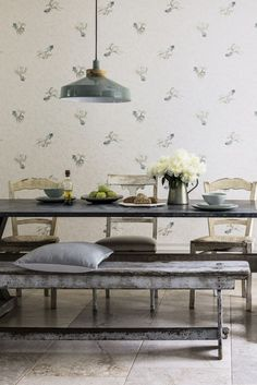 A whimsical wallpaper design featuring a shoal of fantail fish, on a marble effect background.