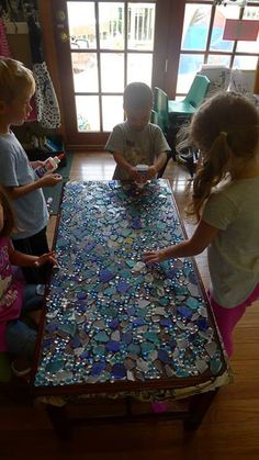 "Making a mosaic table at TreeHouse Preschool ("",)"