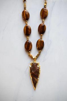 Tigers eye arrowhead necklace. A personal favorite from my Etsy shop. Bohemian luxury jewelry, arrowhead necklace, boho style, bohemian style, bohemian soul