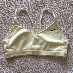 White Nike Dri Fit Sports Bra Lightly loved white Nike Dri Fit sports bra. The only real wear on this is on the band (as pictured) and from washing. All Nike apparel has never been dried in the dryer, only hang dry. Nike Other