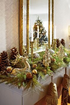 Ceramic reindeer, fleur-de-lis stocking holders, and brass candlesticks glow as they nestle into the mantel greenery. - Traditional Home ®/ Photo: Peter Krumhardt