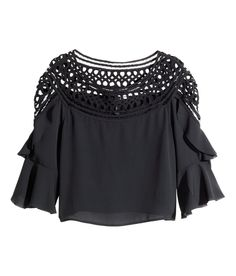 Short black blouse with openwork lace panels, 3/4 sleeves, and decorative ruffles. | H&M Divided