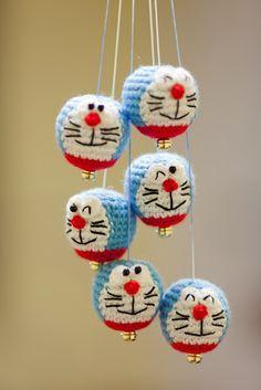 Crocheted Doraemon heads for a hanging mobile. Smile! :)