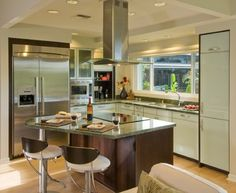 I like the exhaust hood on this one. Stovetop In Kitchen Island Design Ideas, Pictures, Remodel, and Decor