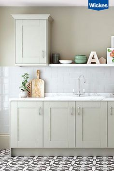 Bring an air of calm to the busiest room of the house with soft sage greys and period style cabinets. Add a dramatic twist with feature floor tiles, sure to give any kitchen a contemporary edge. Complete the look with bright accessories, setting off the colour scheme effortlessly.  Find your perfect kitchen at Wickes.