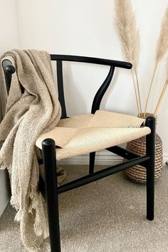 A home is never really complete without a wishbone chair. They're beautiful chairs and comfortable too. This one is especially lovely with the contrasting neutral tones. The chair goes especially well in neutral color palette homes