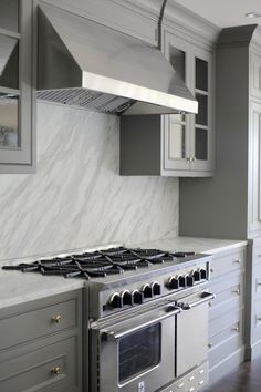 If you'd like a more modern approach cloudy grey cabinets with a wave like white marble slab backsplash is the perfect direction. Grey Kitchen Cabinets, Built In Cabinets, Kitchen Cabinet Design, Kitchen Backsplash, Backsplash Arabesque, Quartz Backsplash, Hexagon Backsplash, Granite Backsplash, Glass Cabinets