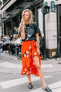 a tee paired with a red floral skirt