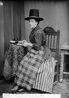 Miss Ada Davies, Bontuchel, drinking tea  in Welsh national dress, c. 1885