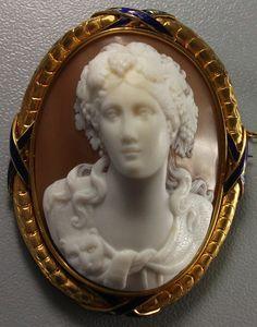 Circa 1850 Sardonyx Shell, 18k gold Italian cameo depicting a Bacchante in front face.