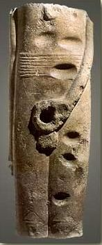 A very early fragmentary statue of the god Min from Coptos dating perhaps to the late Predynastic Period.