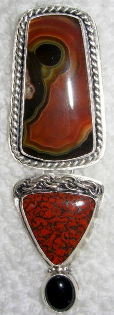 """This pendant has been titled """"Charlie"""" Chelle' Rawlsky Designs Hand forged , layered, shaped and textured sterling silver with a heavy organic patina and matte finishing front and back. Completely backed bezels unless otherwise specified Oh my goodness awesome agua nueva agate paired with an equally amazing dinosaur bone cut by 2 of my favorite lapidary artists and a black onyx accent 2 tiered in design Hangs with a half moon bale 3+ by 7/8+"""" now available in Divas Delights at dot net"""