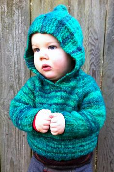 Free Knitting Pattern for Baby Nico Sweater - Hooded pullover for babies. Sizes 3 to 18 months. Designed by Kate Burge and Rachel Price. Aran weight y. Baby Boy Knitting Patterns, Baby Sweater Knitting Pattern, Baby Sweater Patterns, Knitted Baby Cardigan, Knit Baby Sweaters, Knitting For Kids, Free Knitting, Knitting Sweaters, Baby Boy Sweater