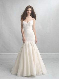 Madison James MJ11 Nothing is more gorgeous than ruched tulle. The texture is soft and architectural, and this gown pairs it with a soft modified A-line skirt and embroidered edging across the bodice