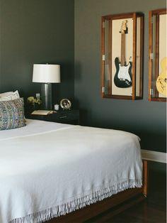 Framed guitars. Moody, dark bedroom by Alexandra Kaehler Design