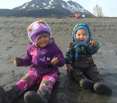 Smiles!!!  And why not? Warm and the get to play in the mud!