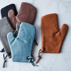 Treat Yo'Self Oven Mitt. Granted, nobody needs a Dutch-made 100 percent full-grain leather oven mitt in an exquisite color Leather Accessories, Kitchen Accessories, Leather Jewelry, Leather Apron, Sewing Leather, Leather Bags, Kitchen Items, Kitchen Products, Kitchen Utensils