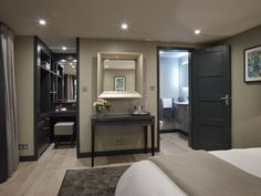 An en-suite shower room and separate dressing area with bespoke storage and mini-bar area. Master Bedroom Plans, Bedroom With Ensuite, Bedroom Loft, Home Decor Bedroom, Hotel Bedroom Design, Modern Bedroom Design, Master Bedroom Design, Loft Conversion Bedroom, Contemporary Garden Rooms