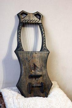 Scandinavian viking musical instruments by ScandicInstruments Harp, Violin, Hammered Dulcimer, Medieval Music, Spiritual Music, Homemade Instruments, Maker Shop, Musical Instruments, Vikings