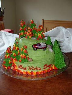Forest fire cake - This was a cake for a firefighter who was leaving his station to go to a brush rig. Trees are ice cream cones with royal icing.