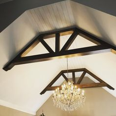 A beautiful chandelier and wood trusses design to liven up your ceiling and add character to you home. Build and design by Black Dog Design House Residential Interior Design, Commercial Interior Design, Commercial Interiors, Interior Design Services, Dog Design, House Design, Wood Truss, Outdoor Living Areas, Design Firms