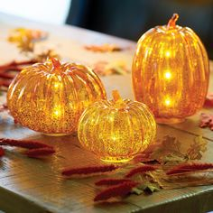 Create a glowing autumn display with our Pre-Lit Mercury Glass Pumpkins, Set of 3. These gorgeous mercury glass pumpkins glow from the inside thanks to a string of warm white LEDs. Composed of orange glass with a crackled mercury finish, they make a breathtaking arrangement and centerpiece.