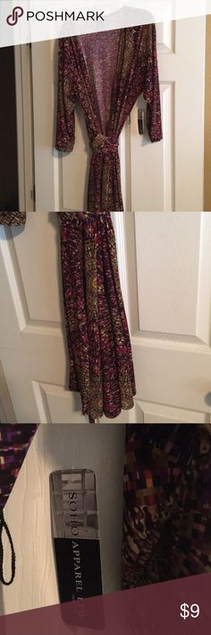 Wrap dress midi NWT Long or 1/4 length sleeves wrap dress. New with tags. Mostly brown in color. Spandex and polyester. Soho Dresses Midi